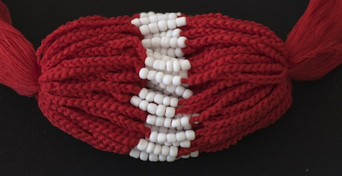 Dark red baby bracelets from Thailand Buddhist wat.