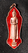Standing copper colored Buddha on red background amulet.