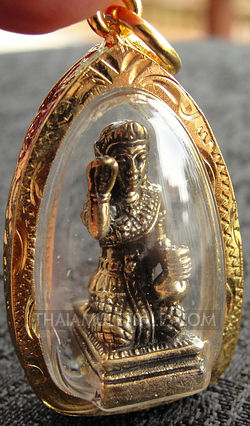 Thai brass Nang Kwak amulet inside gold faceted case.