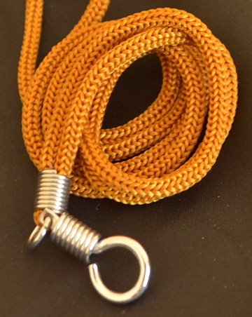 Tan braided nylon necklace.