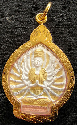 Kwan Yin with thousand arms pendant from Thailand.