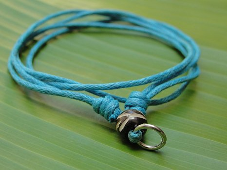 Blue waxed cord necklace.