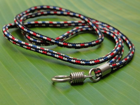 Red, black, blue and white nylon necklace.