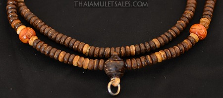 Brown wooden beaded necklace for Thai amulets.