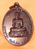 Monk Phra Upakut for protection from danger of tsunami, and other natural disasters.
