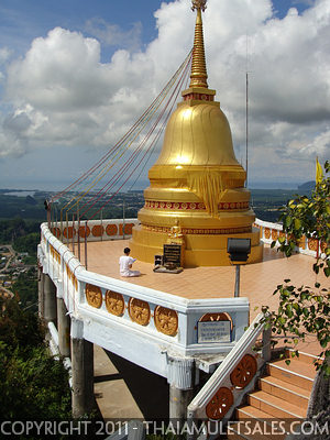 Large chedi on top of 280 meter high mountain at Wat Tham Seua, Krabi, Thailand.