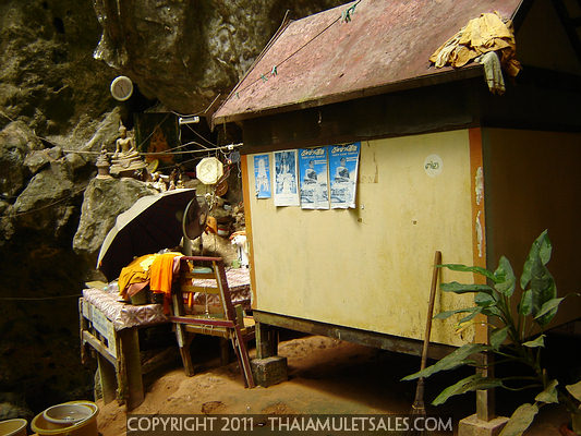 A monk's kuti (home / hut) at the base of large limestone cliffs in Krabi Noi - at Wat Tham Seua Buddhist temple in Krabi, Thailand.