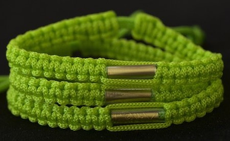 This is a lovely color of olive green Buddhist bracelet that was blessed at the Wat Gaew temple in Southern Thailand.