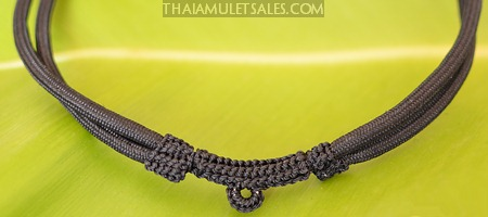 A standard black adjustable nylon cord necklace which fits a range of sizes. Made in Thailand.