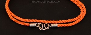 Orange spiral nylon amulet necklace for children