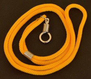 A gold braided nylon necklace made in Bangkok, Thailand.