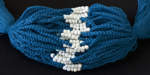 Blue blessed bracelets for babies from Thai Theravada Buddhists in Southern Thailand.