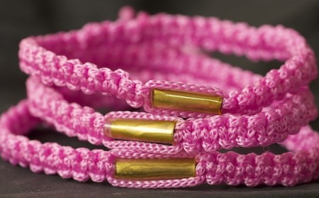 Adjustable pink blessed Buddhist bracelet.