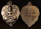 A small solid copper Kwan Yin (Godess of Compassion) amulet for necklace chain.