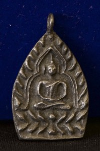 Black aged looking Somdej Buddha Thai amulet from Thailand in an unblossomed lotus shape and blank reverse side.