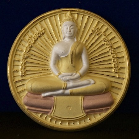 This is a unique Sothorn Buddha amulet in Jatukam style with a radiance eminating from the Buddha's body.