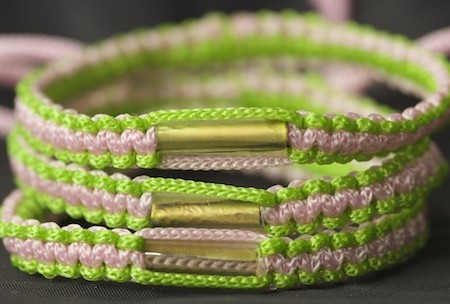 A lime green and pink adjustable blessed Theravada Buddhist bracelet from Southern Thailand. Excellent gift.