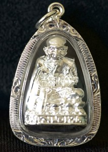 A Thai Luang Phor Tuad amulet with special solid silver case from Wat Mahathat in Southern Thailand.
