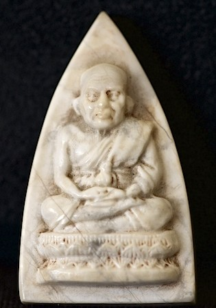 White stone-carved and polished Luang Phor Tuad amulet from Wat Mahathat temple in Bangkok, Thailand. This amulet is stunningly carved in fine detail and looks lifelike.