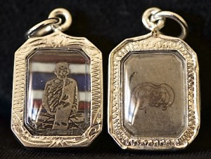 Rectangle shaped Phra Luang Phor Tuad monk on Thai flag in solid silver case.