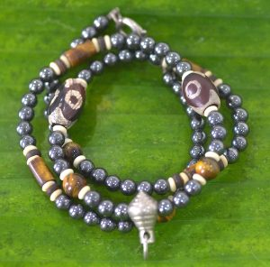 Brown stone and metal bead necklace.