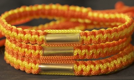 This Thai bracelet is traditional orange and gold colors from Southern Thailand Temple, Wat Mahathat in Nakhon Si Thammarat.