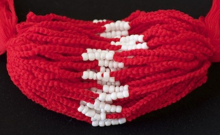 Bright Red beaded baby bracelets for infants, from Southern Thailand Theravada temple.
