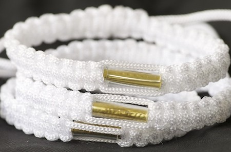 Pure white blessed Theravada Buddhist bracelets from a temple in southern Thailand.